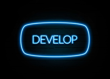 Develop  - colorful Neon Sign on brickwall